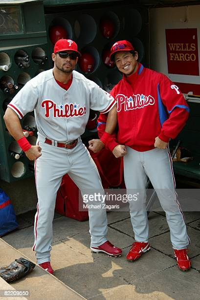 Pedro Feliz and So Taguchi of the Philadelphia Phillies joke around prior to the game against the Oakland Athletics at McAfee Coliseum in Oakland...