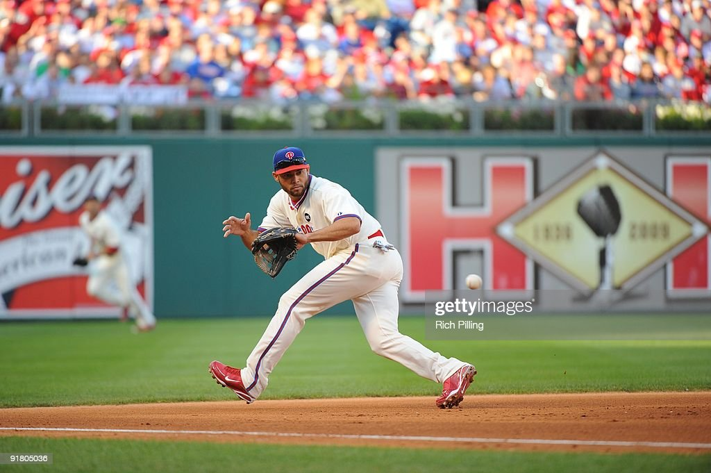 Pedro Feliz of the Philadelphia Phillies fields during Game 2 of the National League Division Series (NLDS) against the Colorado Rockies at Citizens Bank Park in Philadelphia, Pennsylvania on October 8, 2009. The Rockies defeated the Phillies 5-4.