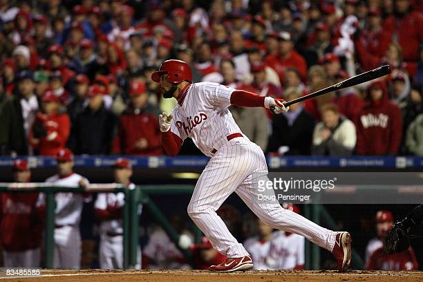 Pedro Feliz of the Philadelphia Phillies hits a RBI single to score Eric Bruntlett in the bottom of the seventh inning against the Tampa Bay Rays...