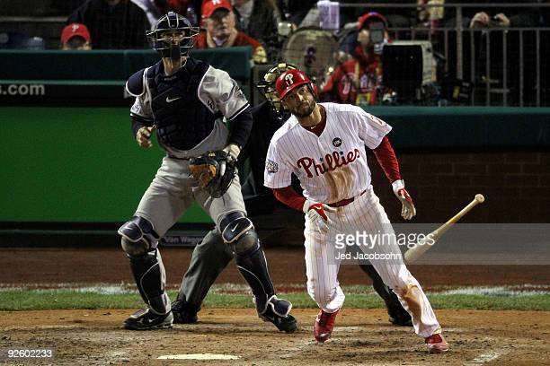 Pedro Feliz of the Philadelphia Phillies hits a solo home run in the bottom of the eighth inning against the New York Yankees in Game Four of the...