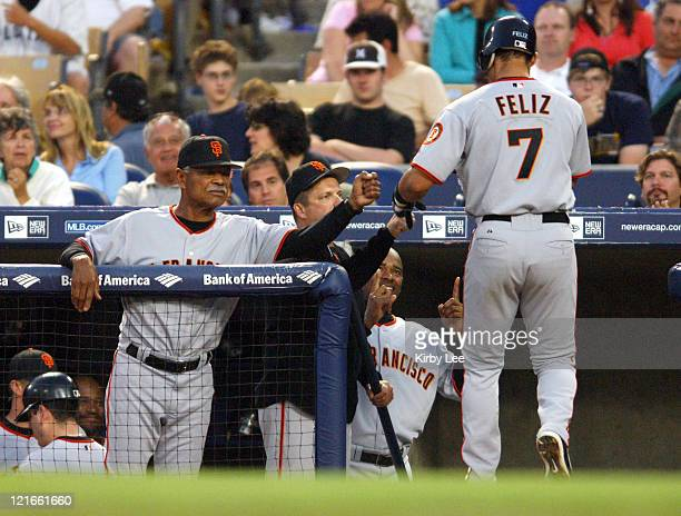 Pedro Feliz of the San Francisco Giants is congratulated by manager Felipe Alou after a secondinning solo home run in 60 victory over the Los Angeles...
