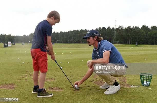 Pedro Figueiredo of Portugal coaching children at a golf clinic on the driving range during Day Two of the Aberdeen Standard Investments Scottish...
