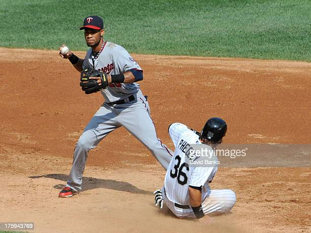 Pedro Florimon of the Minnesota Twins forces out Josh Phegley of the Chicago White Sox at second base during the second inning on August 10 2013 at...