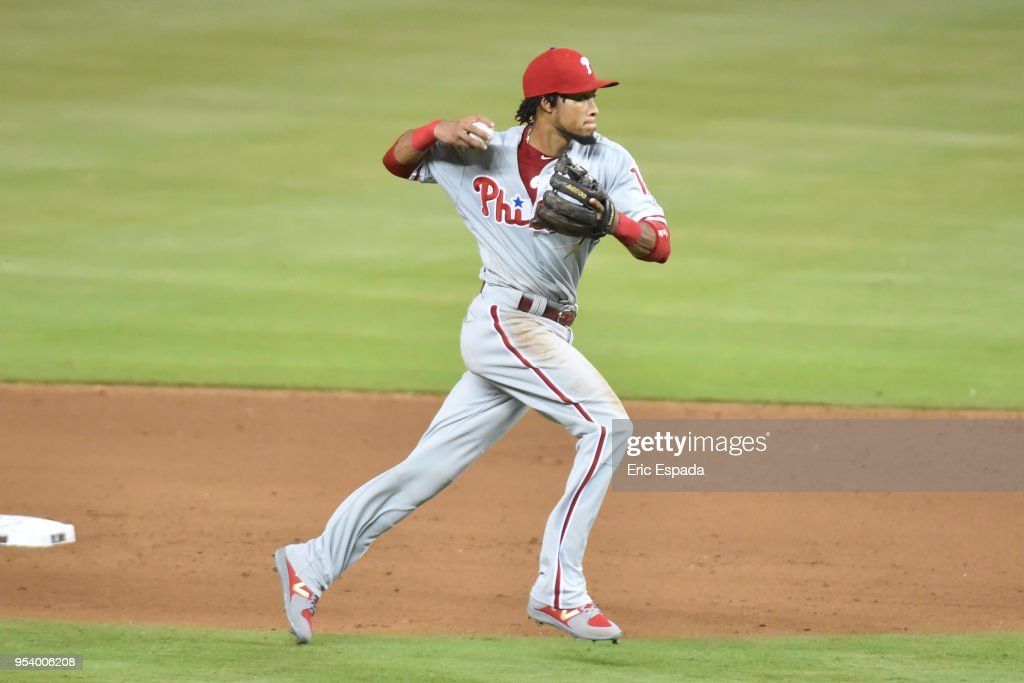 Pedro Florimon #18 of the Philadelphia Phillies throws toward first base during the seventh inning against the Miami Marlins at Marlins Park on May 2, 2018 in Miami, Florida.