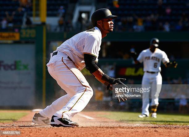 Pedro Florimon of the Pittsburgh Pirates reacts after scoring the goahead run off of a sacrifice fly in the 8th inning against the Chicago Cubs...