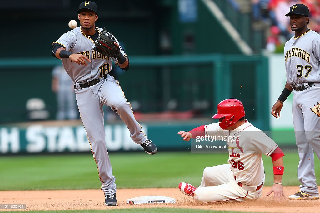 Pedro Florimon #18 of the Pittsburgh Pirates turns a double play over Aledmys Diaz #36 of the St. Louis Cardinals in the seventh inning at Busch Stadium on October 1, 2016 in St. Louis, Missouri.