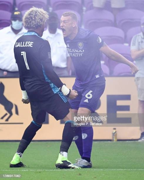 Pedro Gallese and Robin Jansson of Orlando City SC reacts after defeating New York City FC during penalty kicks of Round One of the MLS Cup Playoffs...