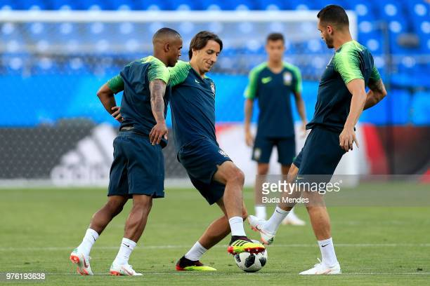 Pedro Geromel Douglas Costa and Renato Augusto of Brazil take part in a drill during a Brazil training session ahead of the FIFA World Cup 2018 at...