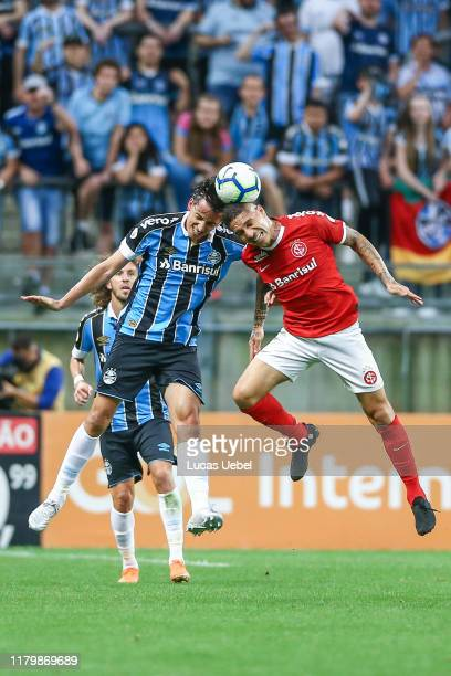 Pedro Geromel of Gremio battles for the ball against Paolo Guerrero of Internacional during the match between Gremio and Internacional as part of...
