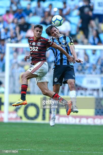Pedro Geromel of Gremio battles for the ball against Reinier of Flamengo during the match between Gremio and Flamengo as part of Brasileirao Series A...