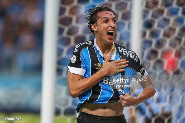 Pedro Geromel of Gremio celebrates their first goal during the match between Gremio and Internacional as part of Brasileirao Series A 2019 at Arena...