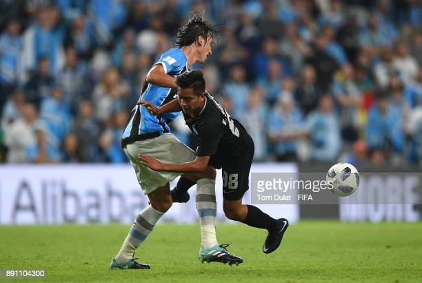 Pedro Geromel of Gremio FBPA and Erick Sanchez of CF Pachuca battle for the ball during the FIFA Club World Cup UAE 2017 match between Gremio FBPA...