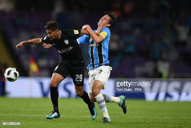 Pedro Geromel of Gremio FBPA and Franco Jara of CF Pachuca battle for the ball during the FIFA Club World Cup UAE 2017 match between Gremio FBPA and...