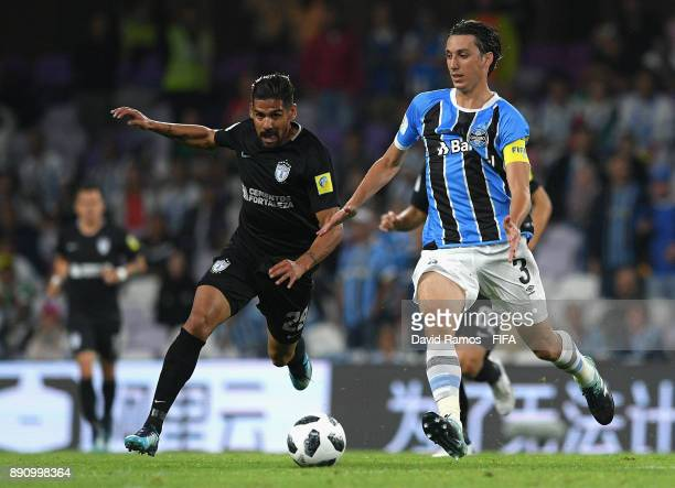 Pedro Geromel of Gremio runs with the ball under pressure from Franco Jara of CF Pachuca during the FIFA Club World Cup UAE 2017 semifinal match...