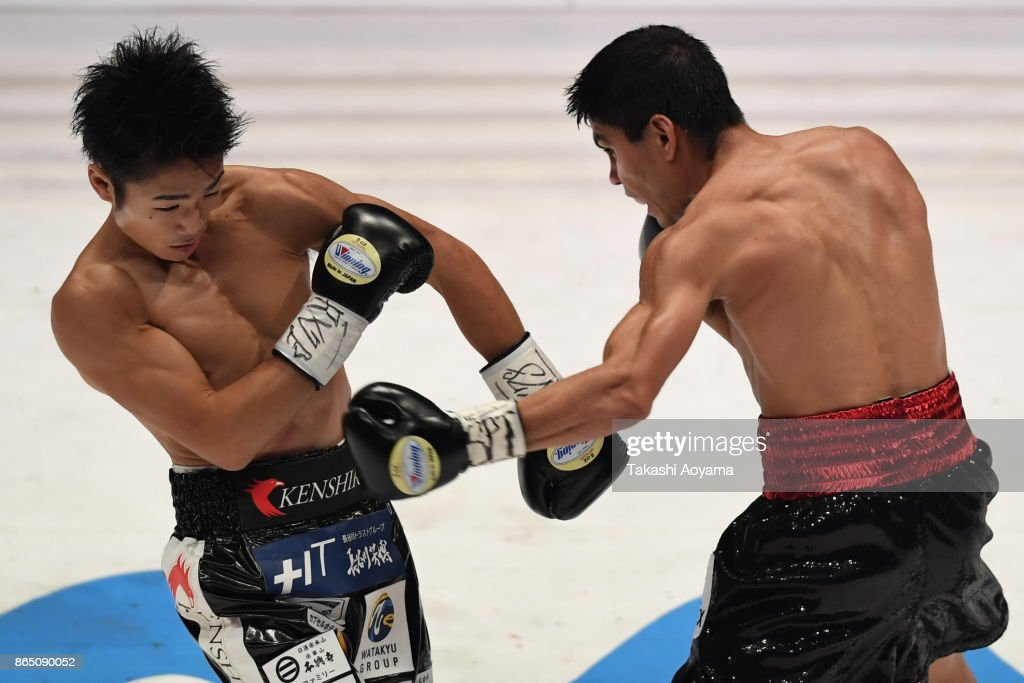 Pedro Guevara of Mexico (R) punches Kenshiro Teraji of Japan during their WBC Light Flyweight Title Bout at Ryogoku Kokugikan on October 22, 2017 in Tokyo, Japan.
