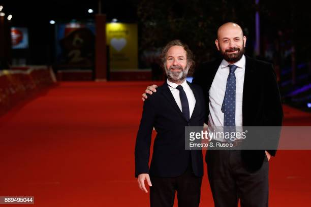 Pedro Hernandez Santos and Antonio Mendez Esparza walk a red carpet for 'Life Nothing More ' during the 12th Rome Film Fest at Auditorium Parco Della...