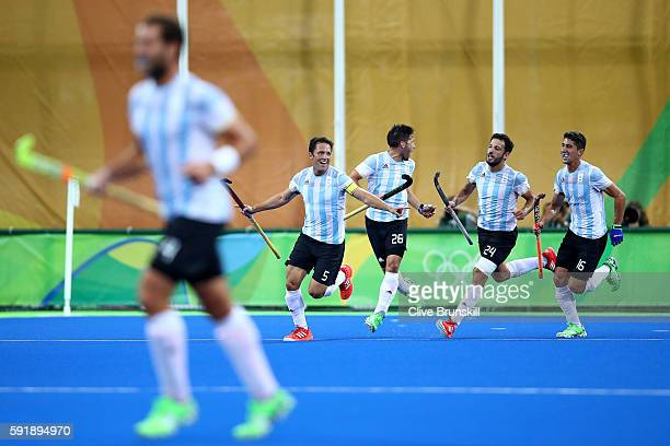 Pedro Ibarra of Argentina celebrates scoring Argentina goal during the Men's Hockey Gold Medal match between Belgium and Argentina on Day 13 of the...