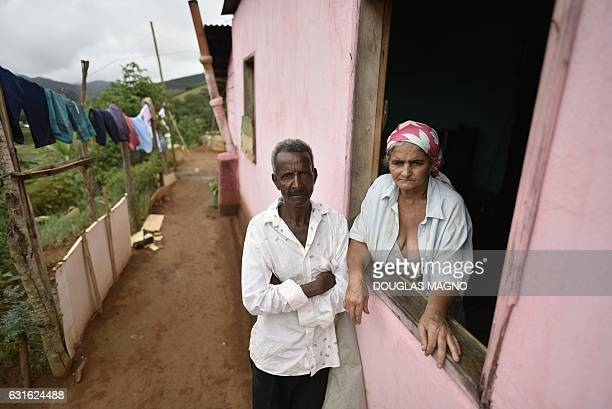 Pedro Joel de Oliveira and Teresinha Gomes de Oliveira the parents of Wellington Santos Cardoso a victim of suspected yellow fever stand at their...