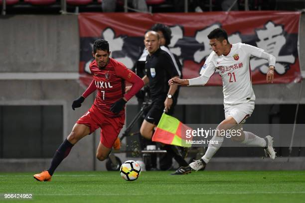 Pedro Junior of Kashima Antlers and Yu Hai of Shanghai SIPG compete for the ball during the AFC Champions League Round of 16 first leg match between...