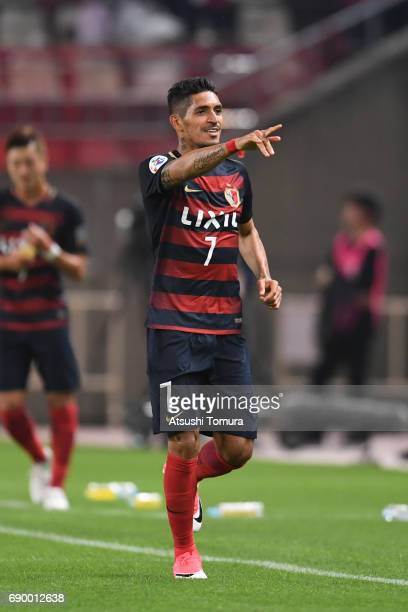 Pedro Junior of Kashima Antlers celebrates after scoring a goal during the AFC Champions League Round of 16 match between Kashima Antlers and...