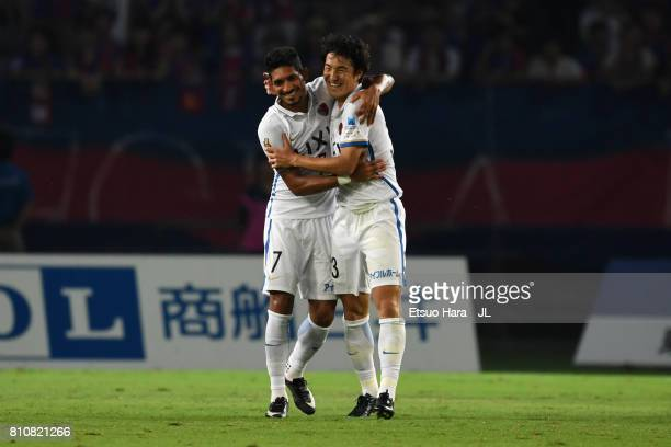 Pedro Junior of Kashima Antlers celebrates scoring his side's first goal with his team mate Mu Kanazaki during the JLeague J1 match between FC Tokyo...