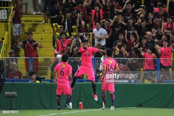 Pedro Junior of Kashima Antlers celebrates scoring his side's third goal with his team mates Ryota Nagaki and Shuto Yamamoto during the JLeague J1...