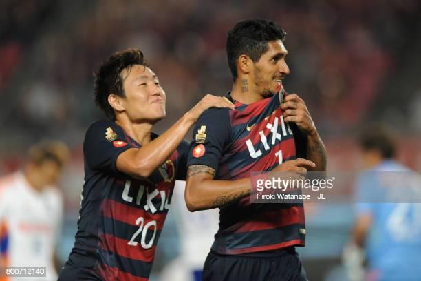 Pedro Junior of Kashima Antlers celebrates scoring the opening goal with his team mate Kento Misao during the JLeague J1 match between Kashima...