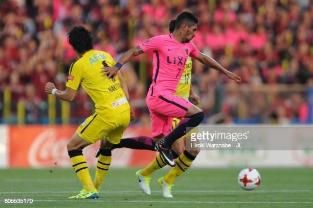 Pedro Junior of Kashima Antlers competes against Shinnosuke Nakatani and Kohei Tezuka of Kashiwa Reysol during the JLeague J1 match between Kashiwa...