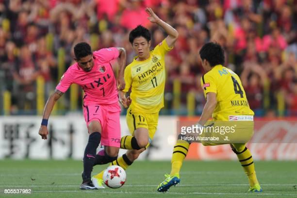 Pedro Junior of Kashima Antlers controls the ball under pressure of Kohei Tezuka and Shinnosuke Nakatani of Kashiwa Reysol during the JLeague J1...