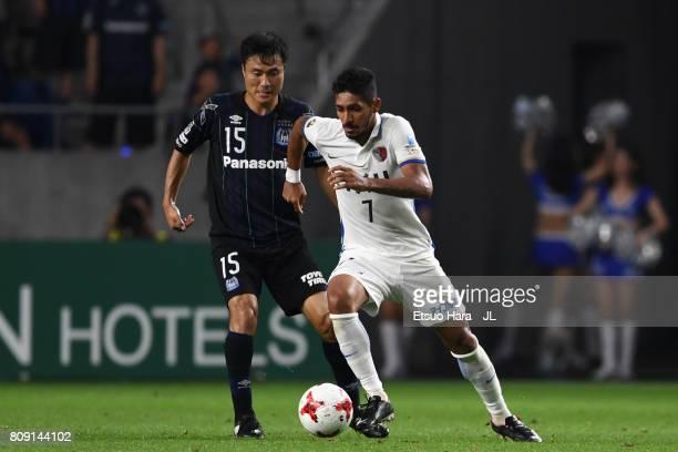 Pedro Junior of Kashima Antlers controls the ball under pressure of Yasuyuki Konno of Gamba Osaka during the JLeague J1 match between Gamba Osaka and...