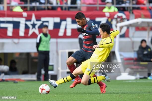 Pedro Junior of Kashima Antlers is tackled by Jiro Kamata of Kashiwa Reysol during the JLeague J1 match between Kashima Antlers and Kashiwa Reysol at...