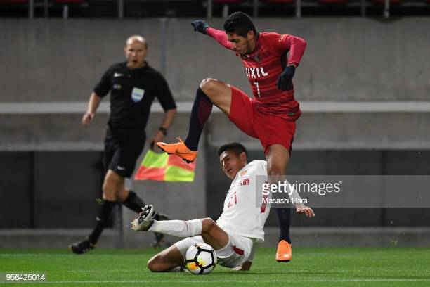 Pedro Junior of Kashima Antlers is tackled by Yu Hai of Shanghai SIPG during the AFC Champions League Round of 16 first leg match between Kashima...