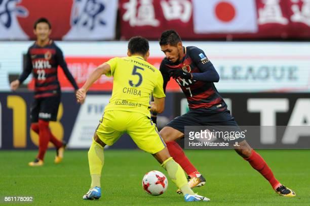 Pedro Junior of Kashima Antlers takes on Kazuhiko Chiba of Sanfrecce Hiroshima during the JLeague J1 match between Kashima Antlers and Sanfrecce...