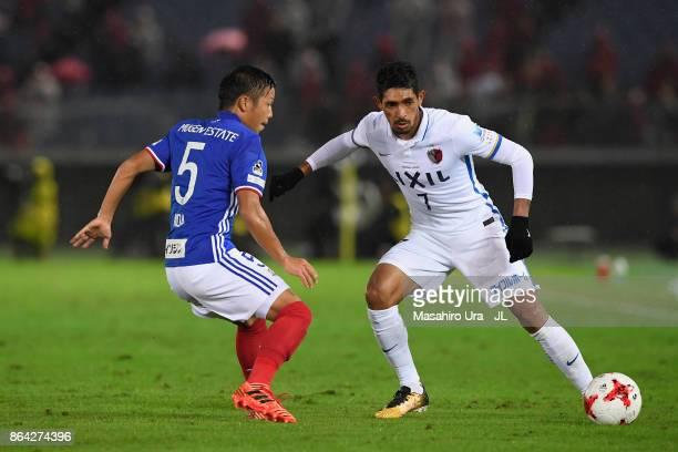 Pedro Junior of Kashima Antlers takes on Takuya Kida of Yokohama FMarinos during the JLeague J1 match between Yokohama FMarinos and Kashima Antlers...