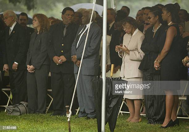 Pedro Knight husband of the late Celia Cruz stands next to Gladys Dacquer sister of Celia Cruz at a public ceremony at Woodlawn Cemetery before the...