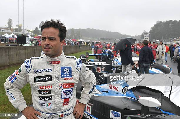 Pedro Lamy, driver of the Team Peugeot Total Peugeot 908 looking over the grid prior to the start of the American Le Mans Series Petit Le Mans at...