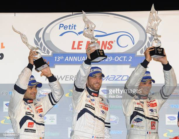 Pedro Lamy of Portugal, Franck Montagny of France and Stephane Sarrazin of France, drivers of the Team Peugeot Total Sport Peugeot 908 celebrate on...