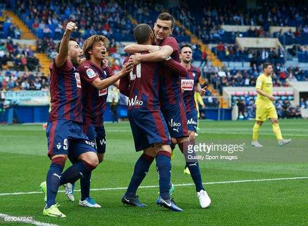 Pedro Leon of Eibar celebrates with his teammates after scoring a goal during the La Liga match between Villarreal CF and SD Eibar at Estadio de la...