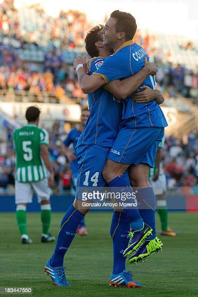 Pedro Leon of Getafe CF celebrates scoring their second goal with his teammate Adrian Colunga during the La Liga match between Getafe CF and Real...