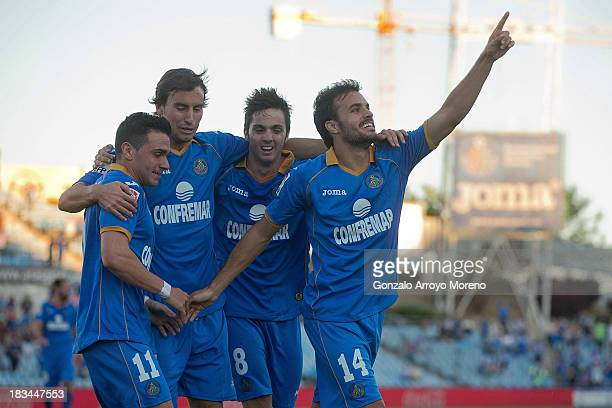 Pedro Leon of Getafe CF celebrates scoring their second goal with teammates during the La Liga match between Getafe CF and Real Betis Balompie at...