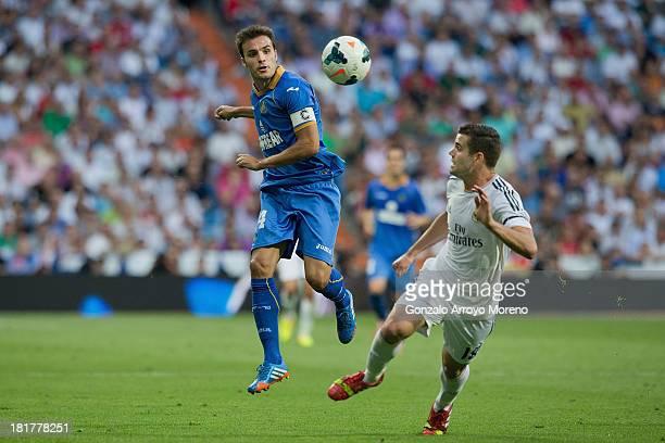 Pedro Leon of Getafe CF runs for the ball against Nacho Fernandez of Real Madrid CFduring the La Liga match between Real Madrid CF and Getafe CF at...