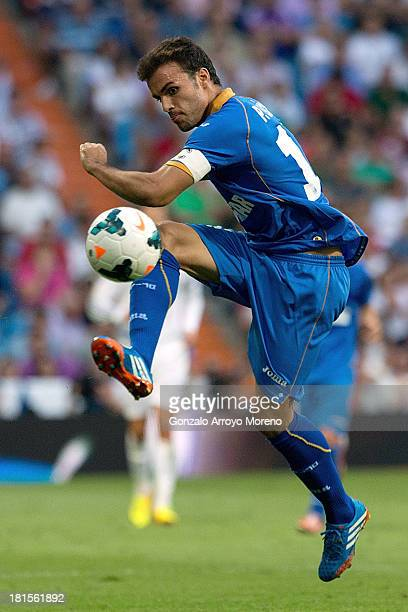 Pedro Leon of Getafe CF strikes the ball during the La Liga match between Real Madrid CF and Getafe CF at Estadio Santiago Bernabeu on September 22...