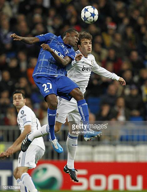 Pedro Leon of Real Madrid jumps for a high ball with Alain Traore of AJ Auxerre during the Champions League group G match between Real Madrid and AJ...