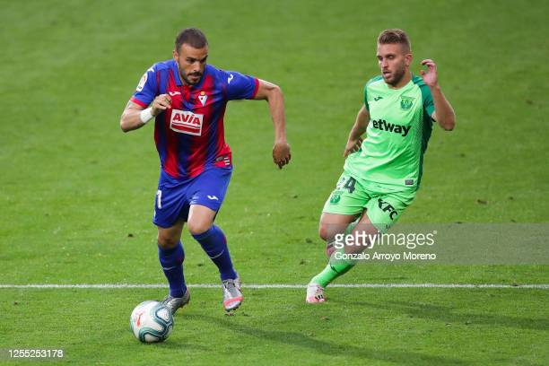Pedro Leon of SD Eibar competes for the ball with Kevin Rodrigues of CD Leganes during the Liga match between SD Eibar SAD and CD Leganes at Ipurua...