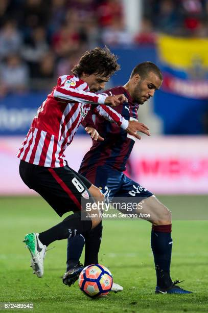 Pedro Leon of SD Eibar duels for the ball with Ander Iturraspe of Athletic Club during the La Liga match between SD Eibar and Athletic Club at Ipurua...
