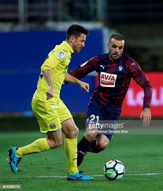 Pedro Leon of SD Eibar duels for the ball with Antonio Rukavina of Villarreal CF during the La Liga match between SD Eibar and Villarreal CF at...