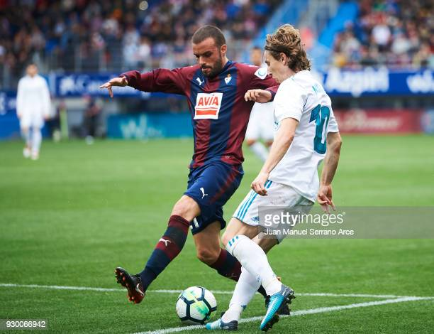 Pedro Leon of SD Eibar duels for the ball with Luka Modric of Real Madrid during the La Liga match between SD Eibar and Real Madrid at Ipurua...