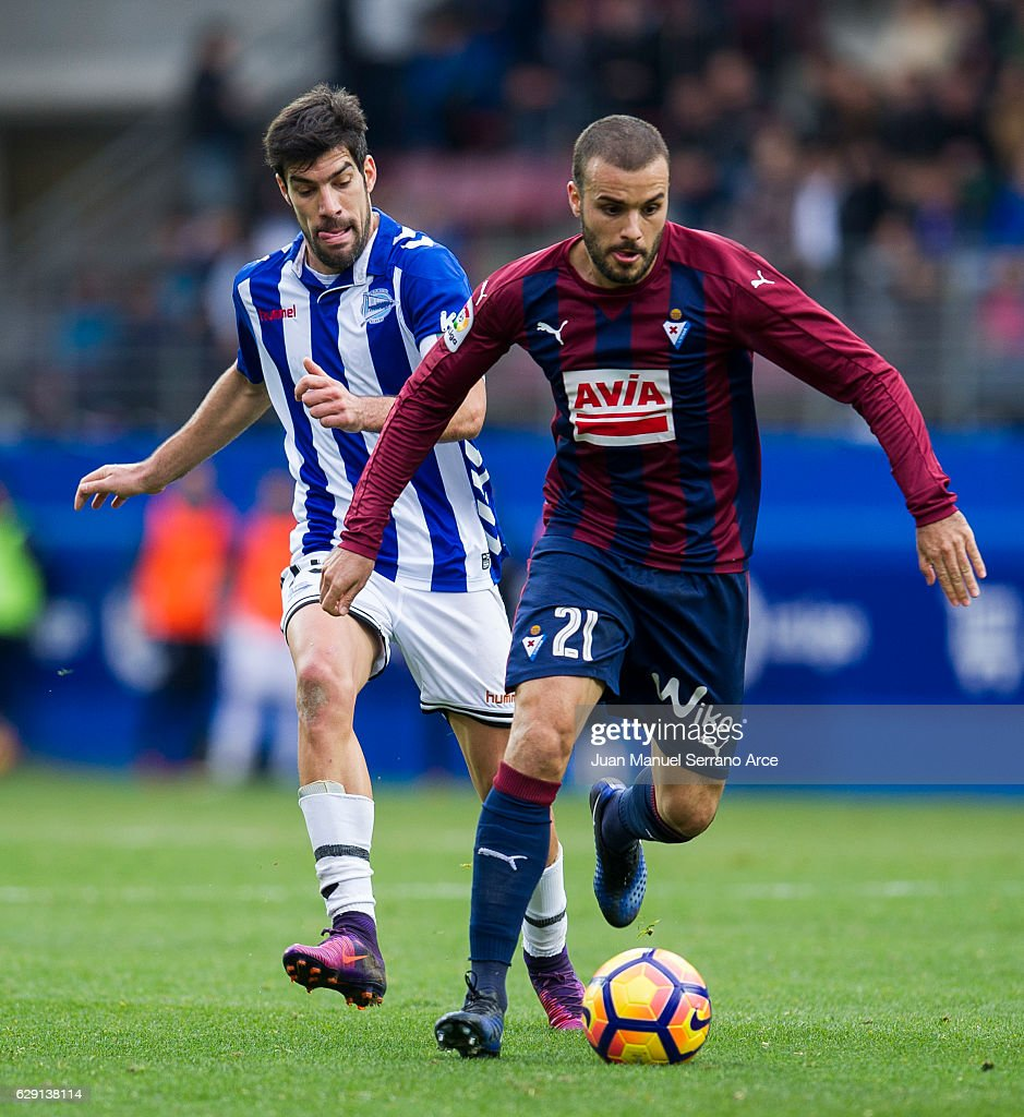 Pedro Leon of SD Eibar duels for the ball with Manuel Garcia of Deportivo Alaves during the La Liga match between SD Eibar and Deportivo Alaves at Ipurua Municipal Stadium on December 11, 2016 in Eibar, Spain.