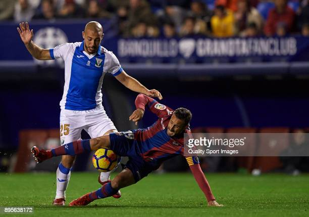Pedro Lopez of Levante competes for the ball with Nordin Amrabat of Leganes during the La Liga match between Levante and Leganes at Ciutat de...