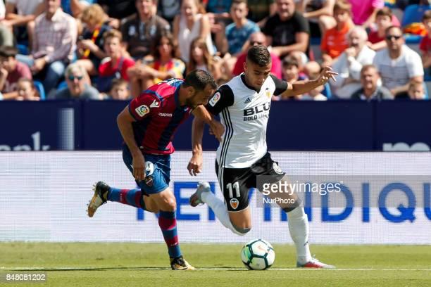 19 Pedro Lopez of Levante Ud in action against 11 Andreas Hugo Hoelgebaum Pereira during spanish La Liga Santander match between Levante UD and...